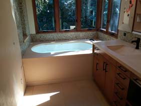 Tan Concrete Bath Tub Surround with Vanity Top