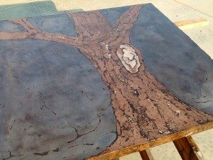 Cast Concrete Table Featuring a Brown and Grey Tree Mural