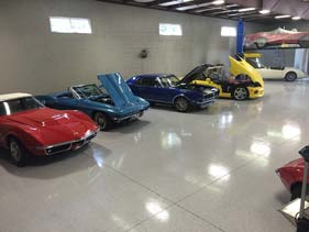 white epoxy garage showroom
