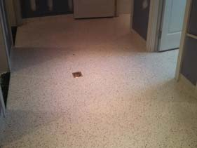 Tan and White Colors Create Sandy Beach Epoxy Flake Floor Design