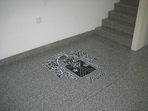 Dark Grey Epoxy Flake Floor with Painted Emblem