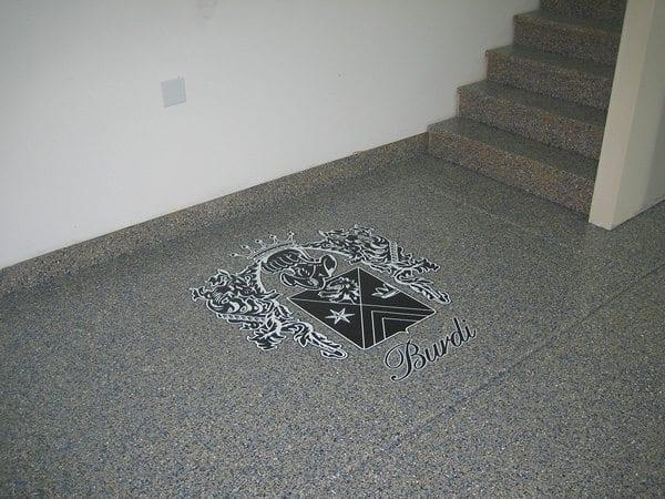 Dark Grey Epoxy Flake Floor with Painted Emblem