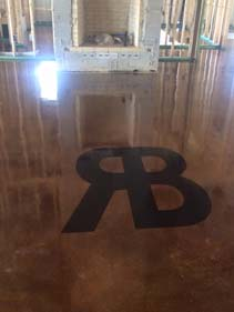 Glossy Stained Concrete Floor With Black Monogram Surecrete Products