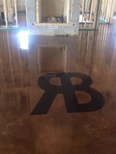 Glossy Stained Concrete Floor Black Monogram Surecrete Products