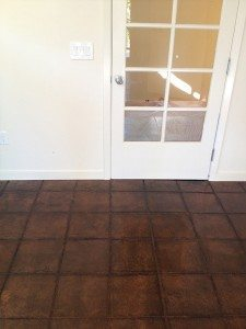 Dark Brown Tile Pattern Concrete Stain
