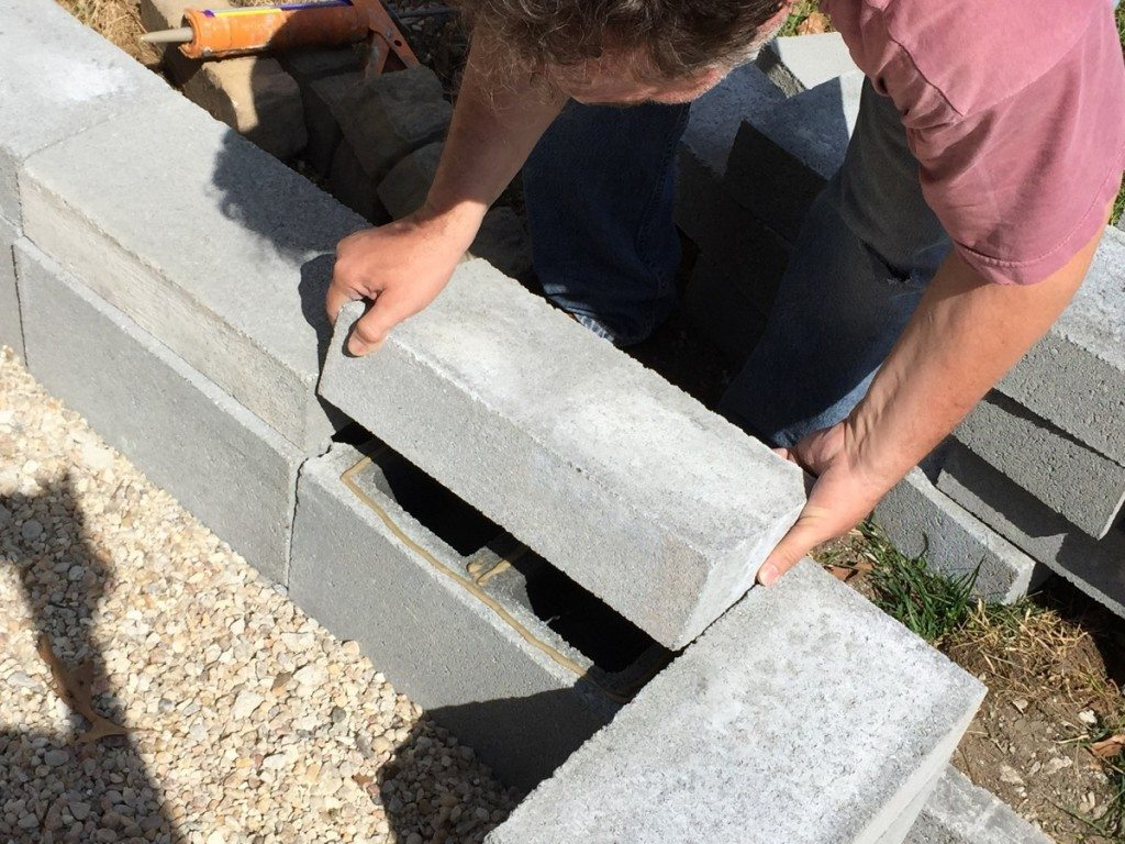 "Adhere 16"" X 8"" solid concrete blocks"