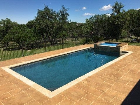 Austin Texas Pool Deck Resurface with Concrete Overlay Tape Pattern
