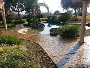 stamped concrete outdoor kitchen pool deck