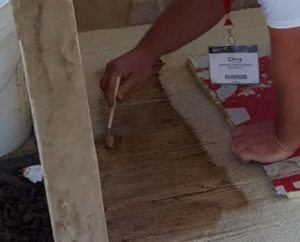 cutting in concrete stain to bring out the wood grain