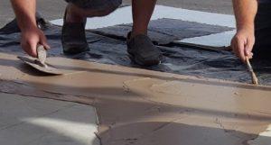 thin concrete overlay over custom tape pattern san buff tan color