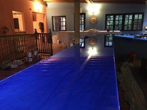 Dark blue metallic concrete bar countertop